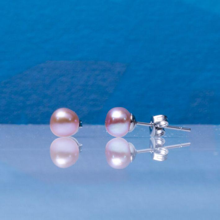 Boucles d'oreilles puces perles de culture roses sur acier argenté