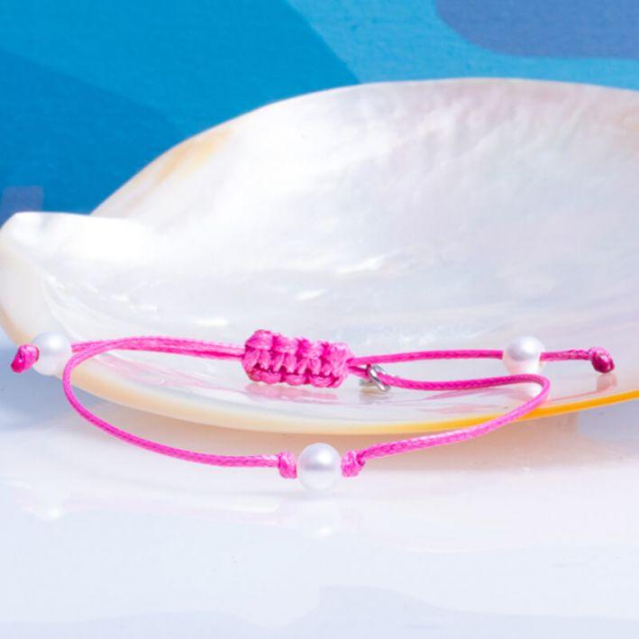 Bracelet coulissant en coton ciré rose et sa perle de culture blanche
