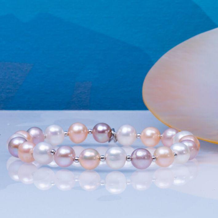 Bracelet perles de culture blanches, roses, pêches et perles en argent massif