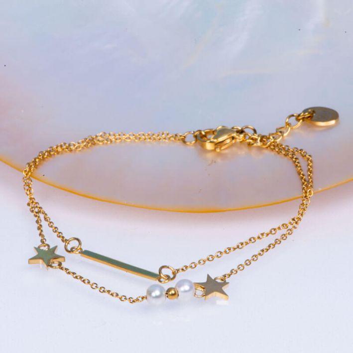 Bracelet double rangs chaîne acier doré, perles de culture blanches et étoiles acier doré