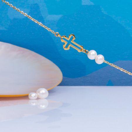 Bracelet deux perles de culture blanche et croix en acier doré