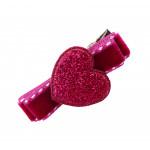 Barrette en velours surpiqué framboise cœur paillette rose
