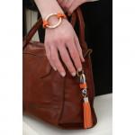 Porte clés cuir et pompon orange