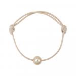 Bracelet une perle nacre dorée sur coton ciré beige
