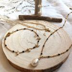 Collier pendentif perle blanche goutte sur petites perles noires