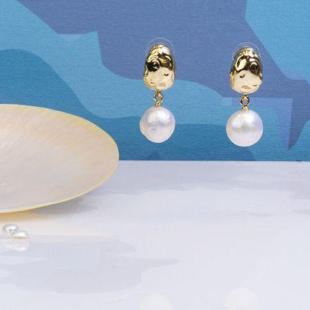 Boucles dormeuses grandes perles baroques