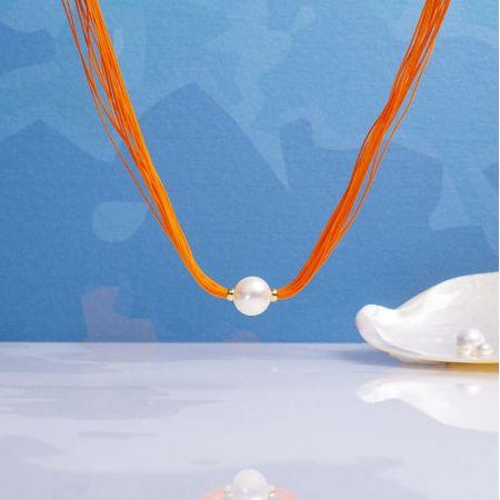 Collier une perle de culture blanche sur multi-cordon orange