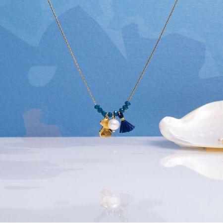 Collier perles cristal bleu saphir et pampilles sur acier doré