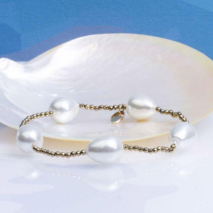 Bracelet perles nacre goutte sur hématite dorée