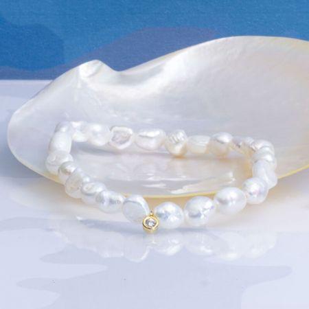 Bracelet perles baroques blanches sur élastique