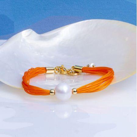 Bracelet une perle de culture blanche sur multi-cordon orange