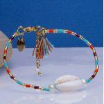 Bracelet perles de rocailles turquoises pompon et Kori