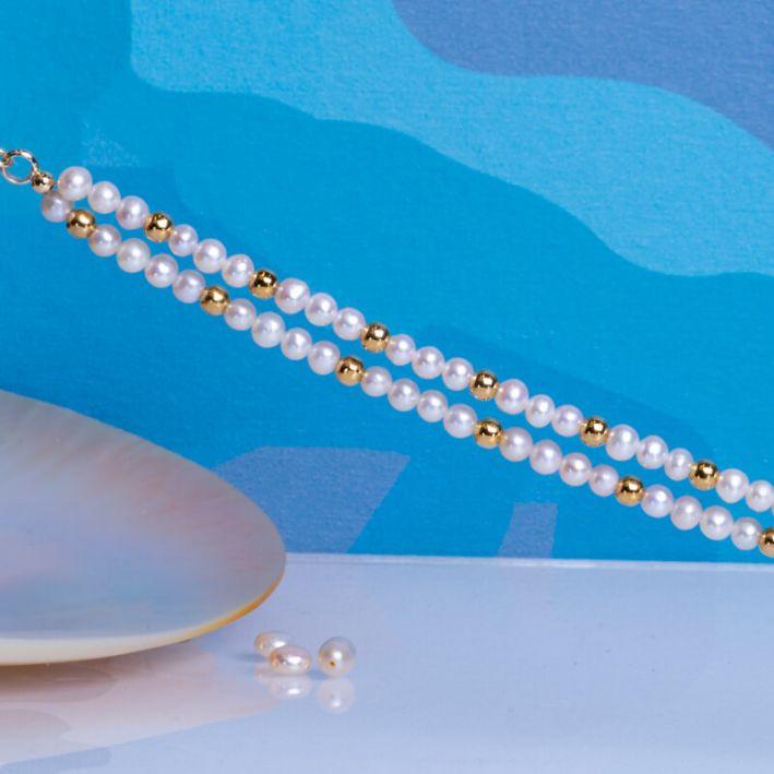 Bracelet double rangs perles de culture blanches et perles en acier doré