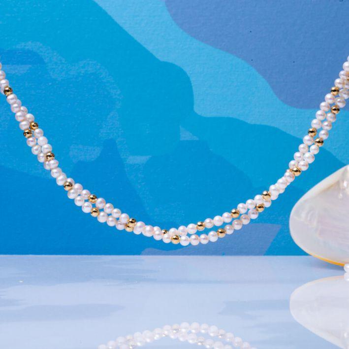 Collier double rangs perles de culture blanches et perles en acier doré